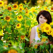 Young  woman with a bouquet of sunflowers in the field  — Stock Photo