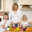 Stock Photo: The happy family makes a dinner in kitchen