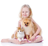 Girl playing with pets - dog and cat — Stock Photo