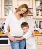 Boy with his pregnant mother — Stock Photo