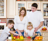 Family Preparing Salad In Kitchen — Stock Photo