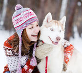 Young woman with dog winter outdoors fun — Stock Photo