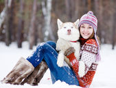 Beautiful girl in winter forest with dog — Stock Photo