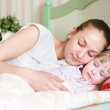 Royalty-Free Stock Photo: Mother and daughter sleep together