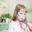 Little girl with a mask for inhalations — Stock Photo