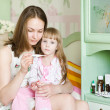 Sick kid with high fever and mother taking temperature — Stock Photo