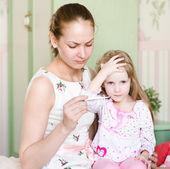 Mother checks temperature at the sick child — Stock Photo