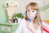 Little girl makes inhalation home — Stock Photo