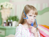 Little girl with a mask for inhalations — Стоковое фото