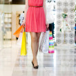 Close-up of beautiful female legs during shopping — Stock Photo