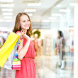 Beautiful young woman with shopping bags — Foto Stock