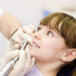 Stock Photo: Close-up medical dentist procedure of teeth polishing with clean