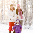Young Family in winter forest — Stockfoto