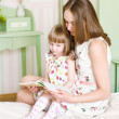 Mother with the daughter read the book — Stock Photo