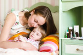 Mother embraces the sick child — Stock Photo