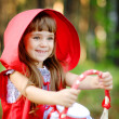 "Girl in the wood with a basket in hands. the fairy tale ""Red Riding Hood"" — Stock Photo #25205343"