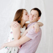 Woman kissing her boyfriend in cheek — Stock Photo #25205347