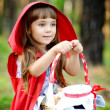 "Girl sits on hemp with a basket looking away.the fairy tale ""Red Riding Hood"" — Stock Photo"