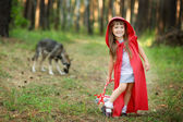 "Wolf pursues the girl. the fairy tale "" Red Riding Hood"" — Stock Photo"