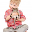 Little boy hugging a kitten. isolated on white background — Stock Photo