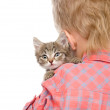 Kitten peeping over the shoulder of a child. isolated on white — Stock Photo
