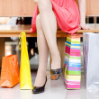 Woman's legs and shopping bags — Stock Photo