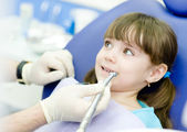 Little girl with open mouth during drilling treatment at the dentist — Stock Photo