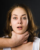 Domestic violence woman being abused and strangled by strong man — Stock Photo
