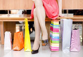 Woman's legs and shopping bags — Stockfoto