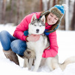 Portrait of a woman with her beautiful dog sitting outdoors — Stock Photo