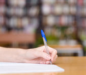 Pen writes in a notebook — Stock Photo