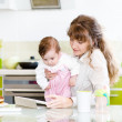 Mother and her little daughter with tablet pc — Stock Photo
