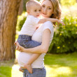 Pregnant mother hugging her son — Stock Photo #28575227