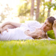 Happy Smiling Couple Relaxing on Green Grass — Stock Photo