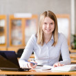 Female student with laptop working in library. — Stock Photo