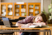 Female student with laptop working in library — Stock Photo