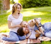 Happy family in park — Stock Photo