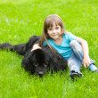 Stock Photo: Girl with Newfoundland dog