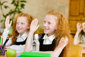 Children raising hands — Stock Photo
