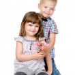 Little boy  giving flowers to girl. — Stock Photo