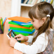 Little girl using tablet computer — Stock Photo