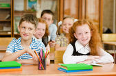 Portrait of schoolkids looking at camera — Stock Photo