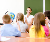 School children in classroom at lesson — Stock Photo