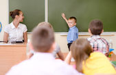 Schoolboy answers questions of teachers — Stock Photo
