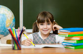 Portrait of lovely girl drawing in copybook — Stock Photo