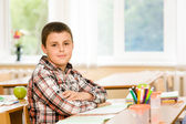 Schoolboy during lesson in classroom — Stock Photo