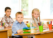 Portrait of pupils looking at camera — Stock Photo