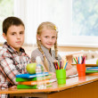Portrait of schoolkids looking at camera at workplace — Stock Photo #31882045
