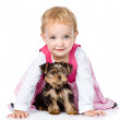 Little girl playing and crawling with a puppy. isolated on white — Stock Photo