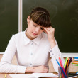 Stock Photo: Tired teacher in classroom